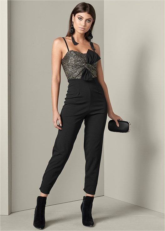 TIE DETAIL JUMPSUIT,FAUX SUEDE POINTY BOOTIES,BEADED MINAUDIERE,LONG TASSEL EARRINGS