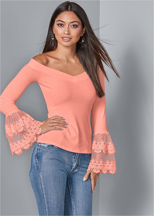 LACE TRIM TOP,COLOR SKINNY JEANS,STUDDED WEDGES,CRISSCROSS HOOP EARRINGS,FLOWER EMBELLISHED HANDBAG,SILICONE BACKLESS LACE BRA
