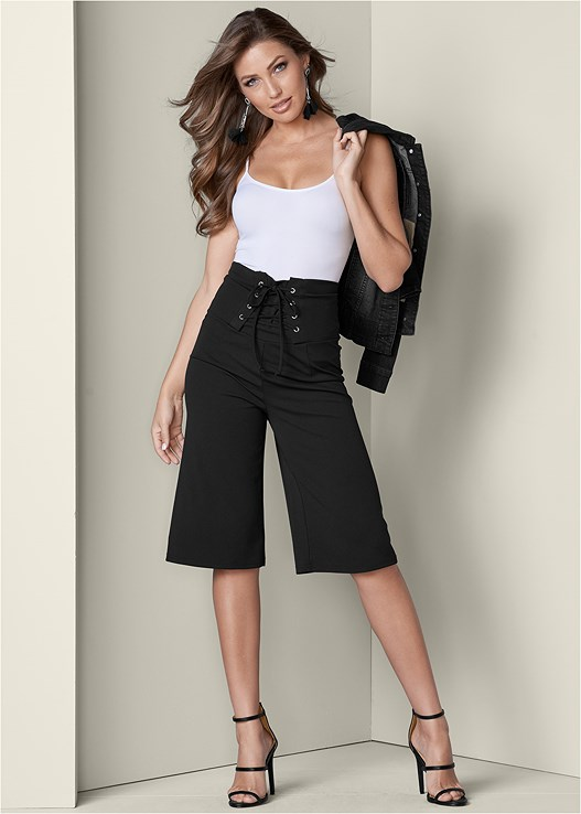 LACE UP DETAIL PANTS,SEAMLESS CAMI,JEAN JACKET,HIGH HEEL STRAPPY SANDALS,BEADED FRINGE EARRINGS