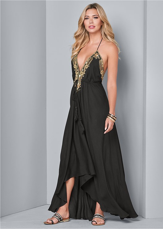 GOLD TRIM MAXI DRESS,CLEAVAGE ENHANCERS,EMBELLISHED HEELS,OVERSIZED TASSEL EARRINGS,STUD DETAIL CROSSBODY