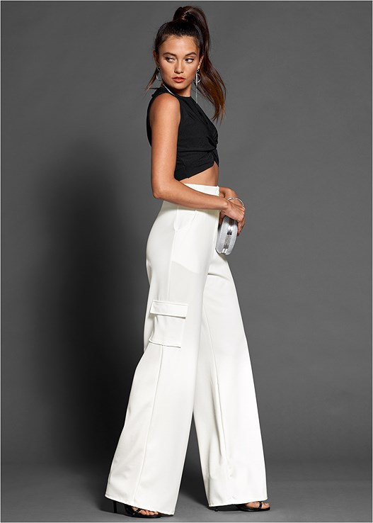 HIGH WAISTED CARGO PANT,CROPPED TWIST FRONT TOP,STUDDED STRAPPY HEELS,RING HANDLE CIRCLE CLUTCH