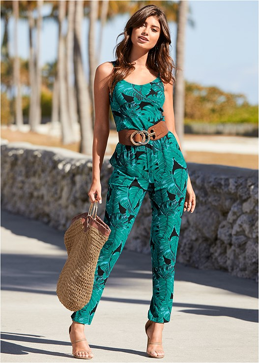 PALM LEAF PRINTED JUMPSUIT,EVERYDAY YOU STRAPLESS BRA,HIGH HEEL STRAPPY SANDALS,RESIN TEARDROP EARRINGS,RING HANDLE STRAW TOTE