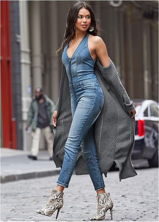 DENIM JUMPSUIT,LONG OPEN FRONT DUSTER,MEDALLION EARRINGS,HIGH HEEL STRAPPY SANDALS