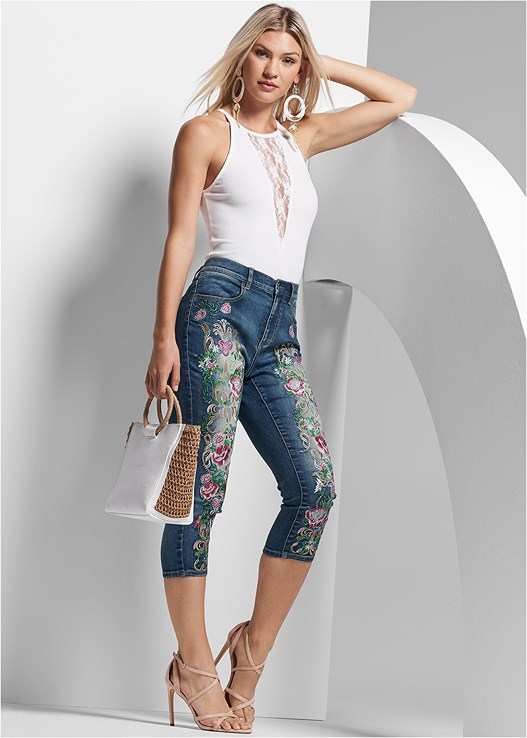 EMBELLISHED DENIM CAPRIS,RUFFLE COLD SHOULDER TOP,FULL FIGURE STRAPLESS BRA,STRAPPY HEELS,LONG CIRCLE EARRINGS,OVERSIZED TASSEL EARRINGS,RAFFIA DETAIL BAG