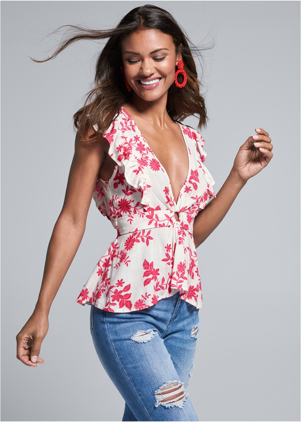 Plunging Floral Top,Triangle Hem Jeans,Beaded Earrings