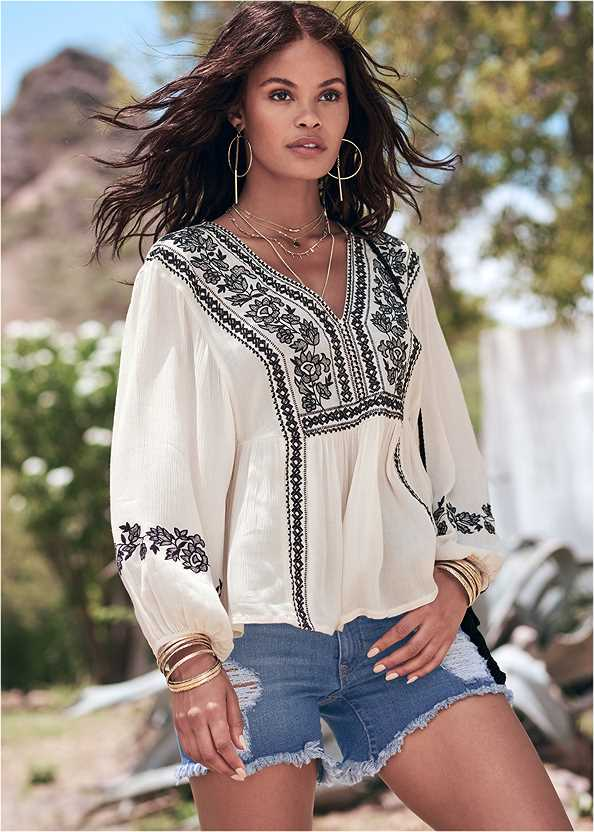 Embroidered Peasant Top,Distressed Jean Shorts,Frayed Cut Off Jean Shorts,Beaded Hoop Earrings,Circular Straw Bag