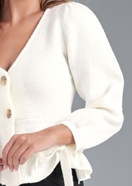 Detail front view Peplum Cardigan
