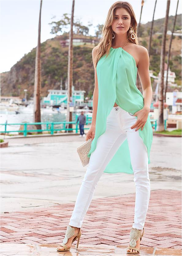 High Low Chain Detail Top,Mid Rise Color Skinny Jeans,Mid Rise Slimming Stretch Jeggings,Beaded Heels,Long Circle Earrings,Shell Detail Clutch