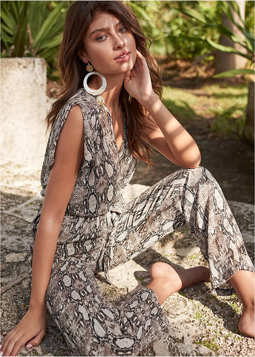 PYTHON JUMPSUIT,PUSH UP BRA,LUCITE DETAIL PRINT HEELS,OVERSIZED TASSEL EARRINGS,ANIMAL PRINT EARRINGS,WICKER STRAW BAG