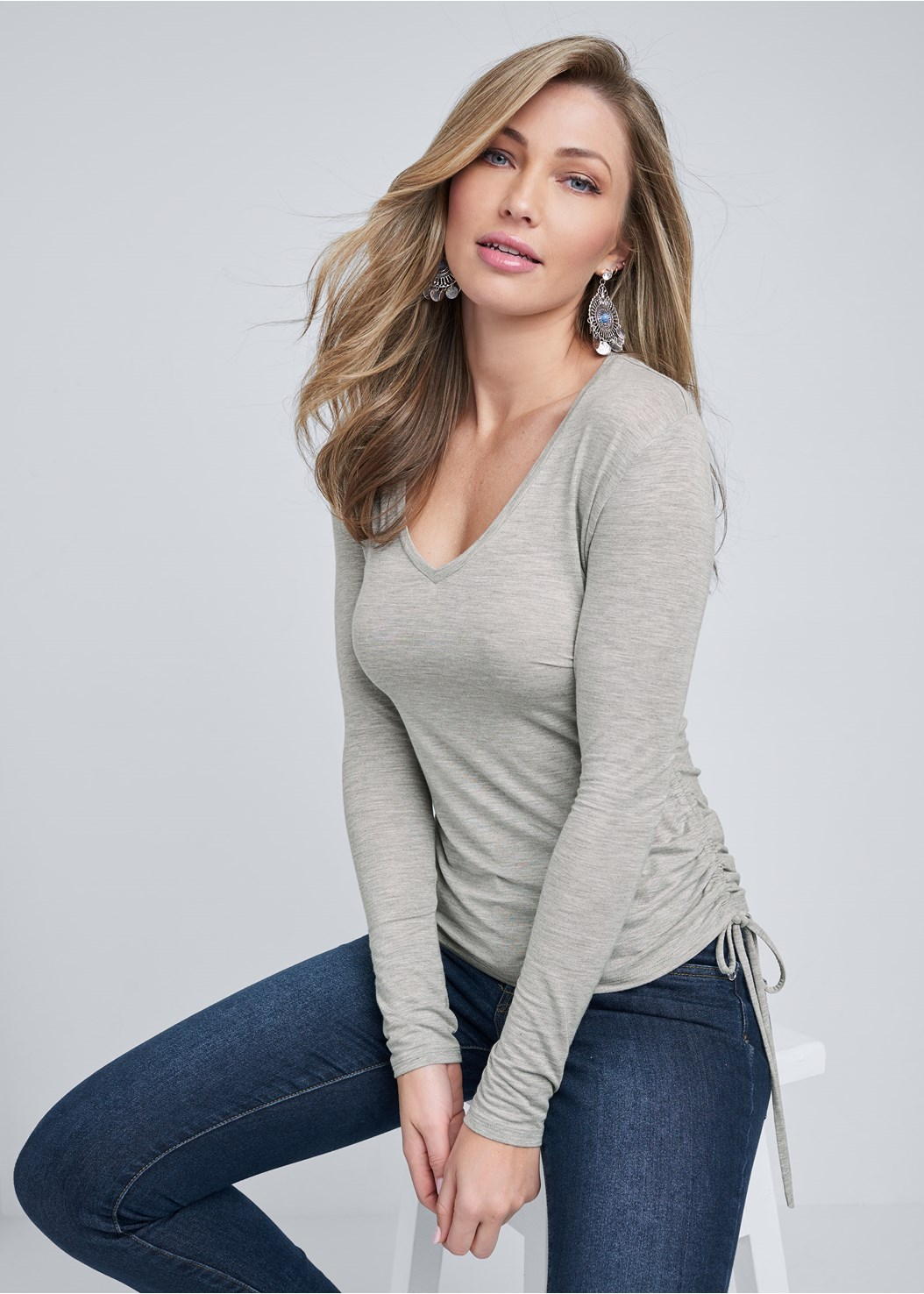 Ruched V-Neck Top,Mid Rise Color Skinny Jeans,Medallion Earrings