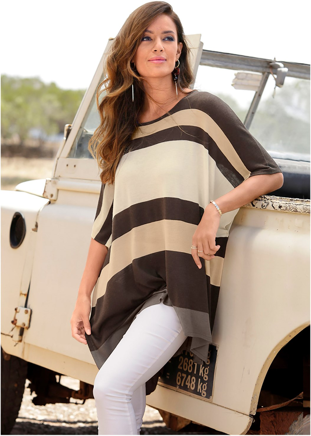 Poncho Sweater,Mid Rise Color Skinny Jeans,Lace Up Gladiator Sandals,Hammered Metal Earrings,Raffia Detail Bag