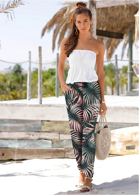 Palm Printed Pants,Off The Shoulder Bodysuit,Multi Color Stone Sandals,Long Circle Earrings,Convertible Straw Tote Bag